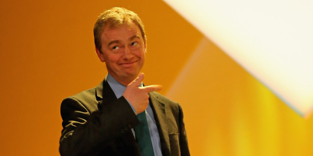 LIVERPOOL, ENGLAND - MARCH 15:  Tim Farron MP carries the Lib DEm 'budget box' on to the stage during the party's spring conference at the ACC on March 15, 2015 in Liverpool, England. Deputy Prime Minister Nick Clegg is expected to rally members and that the Lib Dems will do 'better than anyone thinks' during the general election on 7th May.  (Photo by Christopher Furlong/Getty Images)