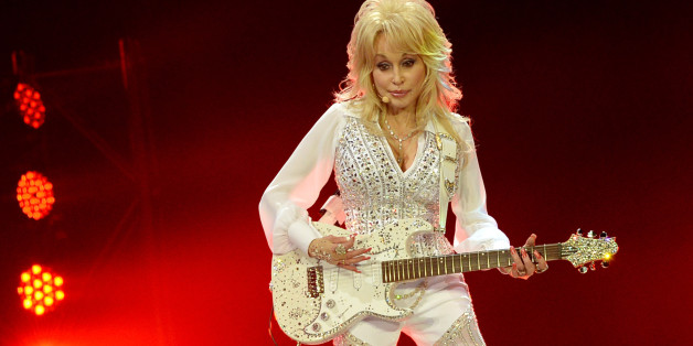 KNOXVILLE, TN - MAY 28:  Dolly Parton performs during a concert to benefit Dolly's Imagination Library & Dr. Robert F. Thomas Foundation at The University of Tennessee's Thompson-boling Arena on May 28, 2014 in Knoxville, Tennessee.  (Photo by Rick Diamond/Getty Images)