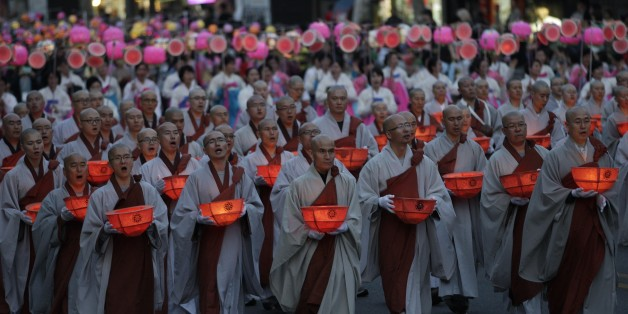 Buddhist monks carry lanterns in a parade during the Lotus Lantern Festival to celebrate the upcoming birthday of Buddha on May 28, on a street in Seoul, South Korea, Sunday, May 19, 2012. (AP Photo/Ahn Young-joon)