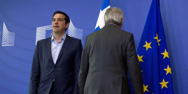 European Commission President Jean-Claude Juncker, right, stands next to Greek Prime Minister Alexis Tsipras as they arrive for a meeting at EU headquarters in Brussels on Wednesday, June 3, 2015. Greece's prime minister meets European Commission President Jean-Claude Juncker in Brussels on Wednesday, June 3, 2015 to discuss his radical left-led government's proposal to secure a vital, long-overdue agreement with the country's bailout lenders. (AP Photo/Virginia Mayo)