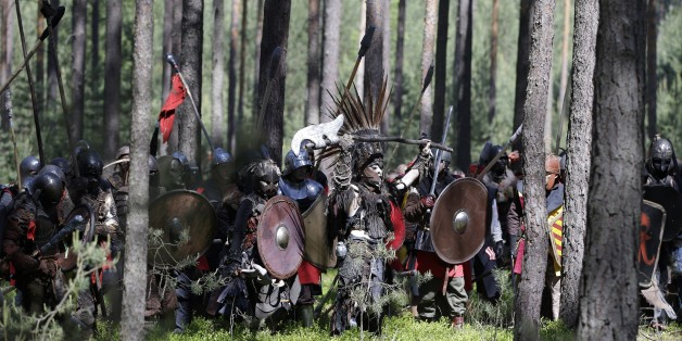 "Enthusiasts dressed as characters from the fantasy novel ""The Hobbit"" by J. R. R. Tolkien take part in the battle of five armies near the town of Doksy, Czech Republic, Saturday, June 6, 2015. Several hundred people arrived in the forest to re-enact the famous battle from Tolkien's novel that was published for the first time in 1937. (AP Photo/Petr David Josek)"