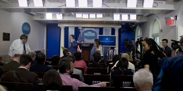 Members of the media enter the White House Briefing Room in Washington, Tuesday, June 9, 2015, to continue the daily briefing after press area was evacuated. Part of the White House was evacuated amid security concerns. Secret Service officers interrupted a live, televised press briefing with the White House press secretary on Tuesday and evacuated the James S. Brady Briefing Room shortly after 2 p.m. The officers would not say what prompted the evacuation, and the White House had no immediate information about the incident. (AP Photo/Carolyn Kaster)