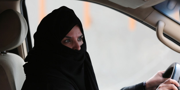 Aziza Yousef drives a car on a highway in Riyadh, Saudi Arabia, Saturday March 29, 2014, as part of a campaign to defy Saudi Arabia's ban on women driving. (AP Photo/Hasan Jamali)