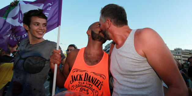 Two men kiss during the annual Gay Pride parade in Athens, Saturday, June 8, 2013. More than 1,000 people took part in the march. (AP Photo/Menelaos Mirilas)3