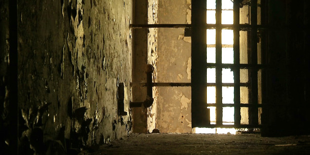 In this June 3, 2015, image taken from video, a hallway is shown in the old Meriwether County jail in Greenville, Ga. The jail, southwest of Atlanta, fell into disrepair after it closed in the mid-1980s. The 119-year-old relic of narrow, aged hallways and small, worn prison cells is being renovated into a home and museum. (AP Photo/Alex Sanz)