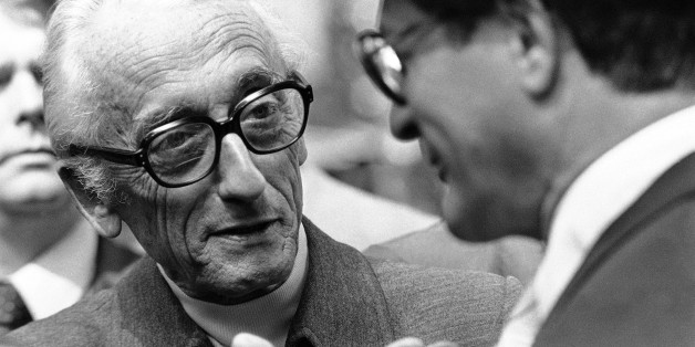Marine explorer Jacques-Yves Cousteau an honorary degree recipient at Harvard University, has a discussion in Cambridge on Thursday, June 7, 1979 with Elliot L. Richardson former secretary U.S., Dept. Health, Education and Welfare, during Harvard commencement in Cambridge, Mass. (AP Photo)