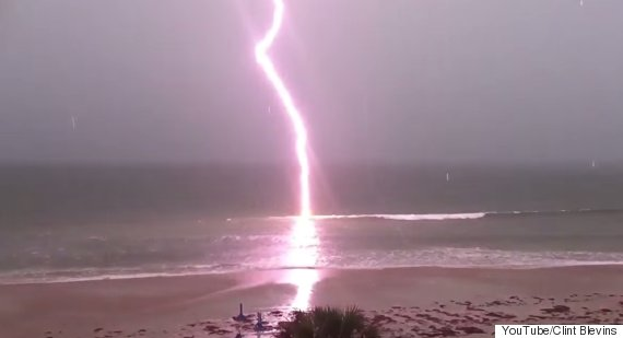 This incredible video shows in slow motion the moment a lightning storm strikes the ocean at Daytona Beach in Miami.