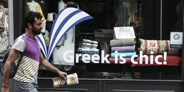 "A man walks past a shop window in Athens, Greece, on Sunday, June 7, 2015.  Greece cannot accept the ""irrational"" proposal made this week by its bailout creditors, Prime Minister Alexis Tsipras told an emergency Parliament session Friday, adding that any deal must also include some lightening of the country's crushing debt load. (AP Photo/Yorgos Karahalis)"