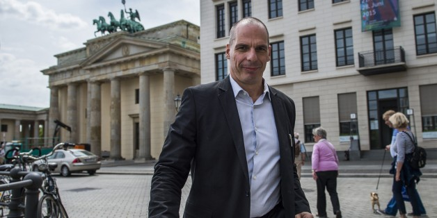 Greek Finance Minister Yanis Varoufakis walks across Pariser Platz in front of the landmark Brandenburger Gate as he shuttles between meetings in Berlin on June 8, 2015. The Greek finance minister met with several politicians including his German counterpart during his visit to Berlin. AFP PHOTO / ODD ANDERSEN        (Photo credit should read ODD ANDERSEN/AFP/Getty Images)
