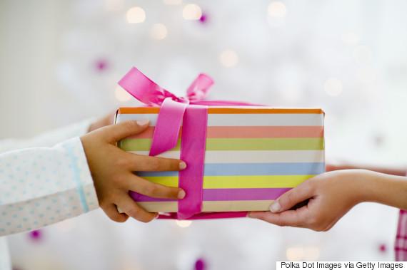 children giving present