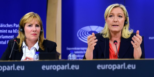 France's far-right National Front (FN) party leader Marine Le Pen (R) holds a press conference at the European Parliament in Brussels, on June 16, 2015, with European Parliament member Janice Atkinson of the UK  to announce a new grouping of European far-right parties, called Europe of Nations and Freedom.  AFP PHOTO / EMMANUEL DUNAND        (Photo credit should read EMMANUEL DUNAND/AFP/Getty Images)