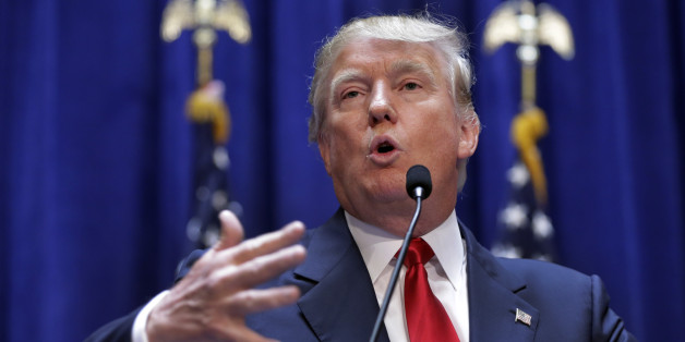 """Developer Donald Trump delivers remarks during his announcement that he will run for president of the United States, in the lobby of Trump Tower, New York,  Tuesday, June 16, 2015. Trump, the 12th high-profile Republican to enter the 2016 race, announced his candidacy in a free-ranging 40-minute speech in which he boasted about his ability to fortify the border with Mexico to prevent """"rapists"""" from entering the U.S. (AP Photo/Richard Drew)"""