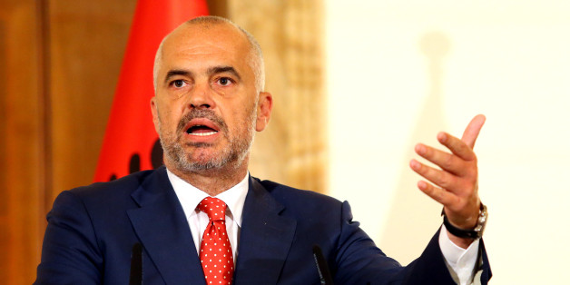 Albanian Prime Minister Edi Rama speaks at the news conference with visiting Serbian Prime Minister Aleksandar Vucic, the first Serbian leader to visit the nation after a troubled past, at the Palace of Brigades in capital Tirana, Wednesday, May 27, 2015. Both countries are trying to overcome their troubled past while working toward EU membership. Relations between the two Balkan states remain strained, mainly over the former Serbian province of Kosovo where majority ethnic Albanians declared independence in 2008 which Serbia refused to recognize.  (AP Photo/Hektor Pustina)