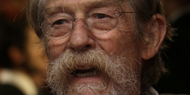 John Hurt poses for photographers at the premiere for the film Fury, which closes the BFI London Film Festival, at the Odeon cinema in central London, Sunday, Oct. 19, 2014. (Photo by Joel Ryan/Invision/AP)
