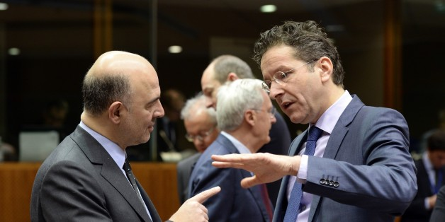 European Union Commissioner for Economic and Financial Affairs Pierre Moscovici (L) speaks with Dutch Finance Minister Jeroen Dijsselbloem prior to the start of a meeting of the Economic and Financial Affairs Council (ECOFIN) at the European Union Council building in Brussels on January 27, 2015. AFP PHOTO / THIERRY CHARLIER        (Photo credit should read THIERRY CHARLIER/AFP/Getty Images)