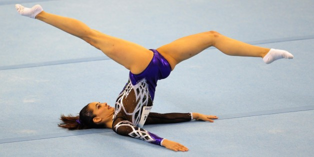 Farah Ann Abdul Hadi of Malaysia competes during the women's floor excercise routine final at the 28th Southeast Asian Games (SEA Games) in Singapore on June 10, 2015. AFP PHOTO / MOHD FYROL        (Photo credit should read MOHD FYROL/AFP/Getty Images)