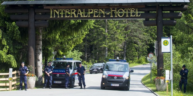 Policemen stand at a checkpoint on a road leading to the Interalpen-Hotel Tirol, venue of the Bilderberg conference, on June 12, 2015 near Telfs, Austria. The Bilderberg group, which brings together international leaders from politics, high finance, business and academia holds its highly exclusive annual meeting in a luxury hotel in the Austrian Alps.  AFP PHOTO / CHRISTIAN BRUNA        (Photo credit should read CHRISTIAN BRUNA/AFP/Getty Images)