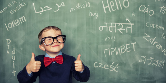 A young language master boy knows how to say hello in many different languages. All languages and cultures are beautiful.