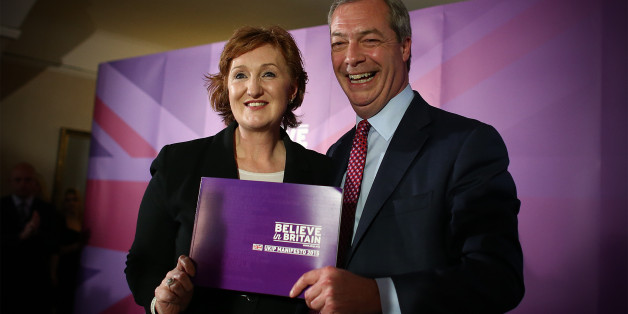 THURROCK, ENGLAND - APRIL 15:  UK Independence Party (UKIP) leader Nigel Farage and deputy chairman, Suzanne Evans, pose with the party manifesto during the launch on April 15, 2015 in Thurrock, England. The party's proposals include extra money for the NHS, a minimum of 2 per cent of GDP to be spent on defence and a five-year ban on unskilled immigration. Britain goes to the polls in a general election on May 7. (Photo by Carl Court/Getty Images)