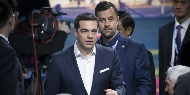 Greek Prime Minister Alexis Tsipras arrives at a plenary session of the St. Petersburg International Investment Forum in St.Petersburg, Russia, Friday, June 19, 2015.  (AP Photo/Alexander Zemlianichenko)