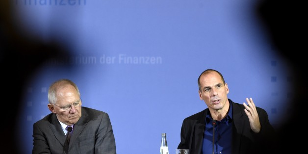 Greece's new Finance Minister Yanis Varoufakis (R) and his German counterpart Wolfgang Schaeuble (L) attend a joint press conference following their meeting on February 5, 2015 at the Finance ministry in Berlin. The new Greek finance minister's stop in Berlin follows a high-stakes visit to ECB headquarters in Frankfurt to try to drum up support for the new anti-austerity government's debt relief bid.  AFP PHOTO / ODD ANDERSEN        (Photo credit should read ODD ANDERSEN/AFP/Getty Images)