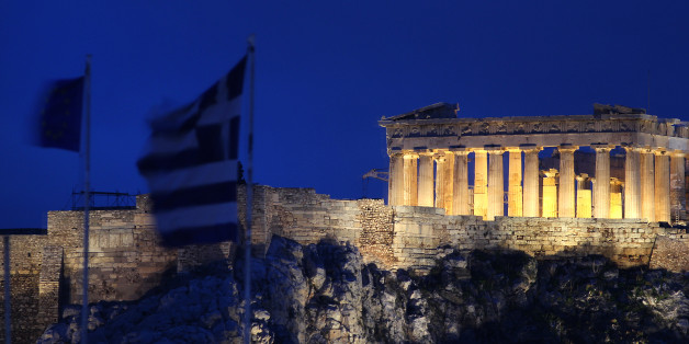 The flags of Greece, 2nd left, and European Union flutter from the roof of the Finance Minister at Athens' main Syntagma square, as in the background is seen the ancient Parthenon temple during in Athens on Thursday Feb, 9, 2012. Greece's deputy labor minister has resigned to protest demanded new austerity measures. Yiannis Koutsoukos issued a statement on Thursday saying he opposes implementation of cutbacks and reforms agreed earlier Thursday to secure the country's international rescue loan lifeline. Koutsoukos is a lawmaker with the majority Socialist party. (AP Photo/Dimitris Messinis)