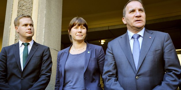 Green Party spokespersons Gustav Fridolin, left, Asa Romson, centre, and leader of Sweden's Social Democrats Stefan Lofven pose for photographer Monday Sept. 15, 2014. Lofven announced that he will form a government together with the Green Party. (AP Photo/ Henrik Montgomery) SWEDEN OUT