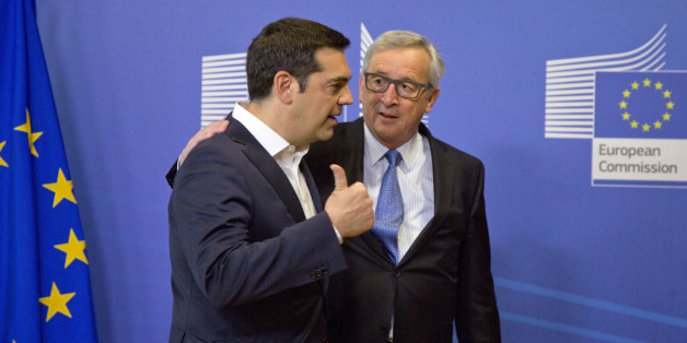 Greek Prime Minister Alexis Tsipras, left, speaks with European Commission President Jean-Claude Juncker as he arrives for a meeting prior to an EU summit at EU headquarters in Brussels on Monday, June 22, 2015. Heads of state in the eurogroup will meet in Brussels on Monday for a special summit to discuss the financial crisis with Greece. (AP Photo/Virginia Mayo)
