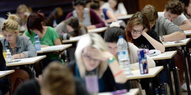French students work on the test of philosophy as they take the baccalaureat exam (high school graduation exam) on June 16, 2014 at the Fustel de Coulanges high school in Strasbourg, eastern France. Some 686 907 candidates are registered for the 2014 session. AFP PHOTO/FREDERICK FLORIN        (Photo credit should read FREDERICK FLORIN/AFP/Getty Images)