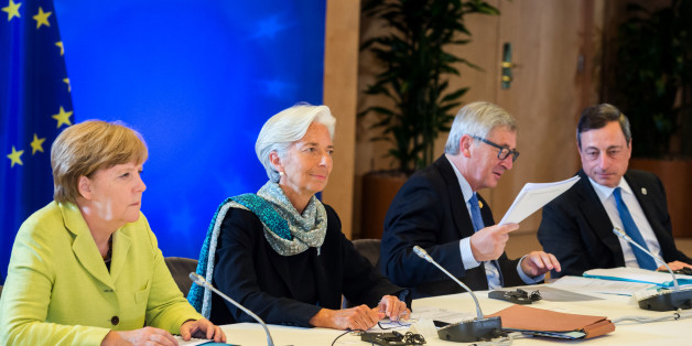 From left, German Chancellor Angela Merkel, Managing Director of the International Monetary Fund Christine Lagarde, European Commission President Jean-Claude Juncker and European Central Bank Governor Mario Draghi participate in a meeting at an EU summit at the European Council building in Brussels on Monday, June 22, 2015. Heads of state in the eurogroup meet in Brussels Monday for a special summit to discuss the financial crisis with Greece. (AP Photo/Geert Vanden Wijngaert)