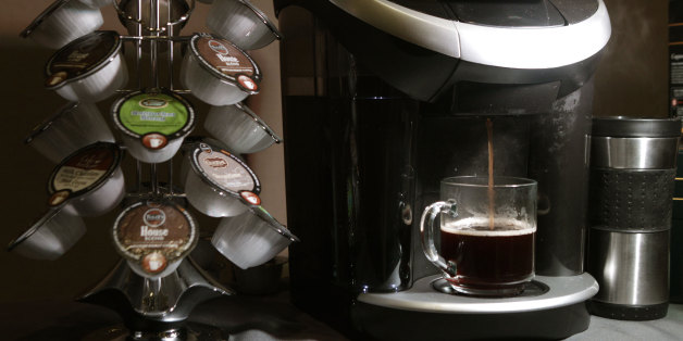 Keurig's Vue individual coffee roasting system is displayed during a Green Mountain Coffee Roasters news conference in New York, Wednesday, Feb. 15, 2012.  The coffee machine can also prepare frothy hot beverages as well as iced drinks. (AP Photo/Kathy Willens)