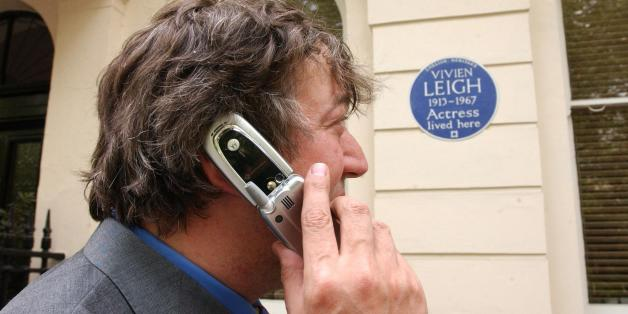 Actor and writer Stephen Fry poses outside 54 Eaton Square in London - the former home of actress Vivien Leigh - during the launch of 'Handheld History' . The innovative new guide for mobile phone users links them to the lives of famous figures commemorated with English Heritage Blue Plaques in Central London.