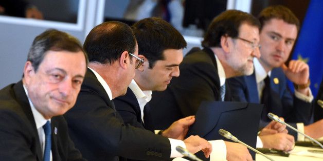 French President Francois Hollande, second left, speaks with Greek Prime Minister Alexis Tsipras, center, during a meeting with other eurogroup heads of state at an EU summit in Brussels on Monday, June 22, 2015. Heads of state in the eurogroup meet in Brussels Monday for a special summit to discuss the financial crisis with Greece. (AP Photo/Geert Vanden Wijngaert)