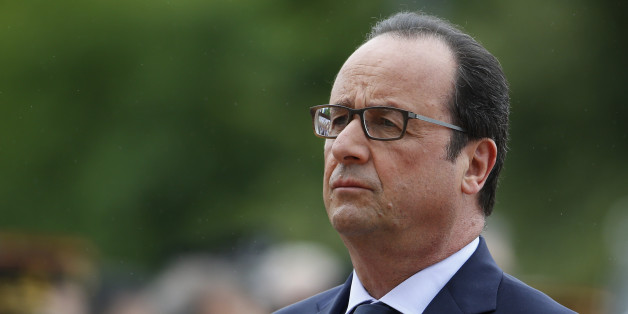 "French President Francois Hollande is pictured during a ceremony to commemorate General de Gaulle's ""Appeal of June 18th"" during World War II, Thursday, June 18, 2015, in Suresnes, near Paris, France. In his famous appeal, De Gaulle exhorted the French to resist the German occupation. (Thomas Samson, Pool via AP)"