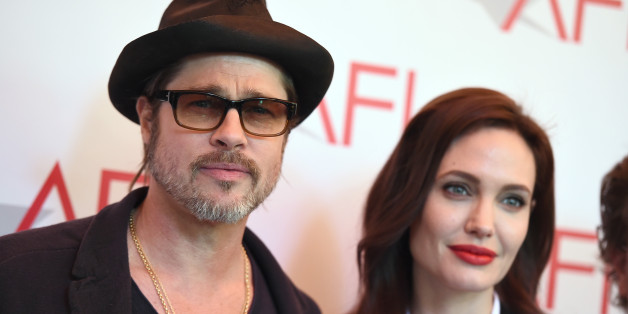 Brad Pitt, left, and Angelina Jolie arrive at the AFI Awards at The Four Seasons Hotel on Friday, Jan. 9, 2015 in Los Angeles. (Photo by Jordan Strauss/Invision/AP)
