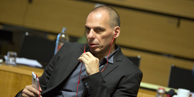 Greek Finance Minister Yanis Varoufakis uses a phone as he waits for the start of a round table of EU finance ministers at the European Council building in Luxembourg on Friday, June 19, 2015. Europe was scrambling Friday to pick up the pieces after another failed meeting over Greece's bailout that reinforced fears that the country was heading for bankruptcy and a possible euro exit. (AP Photo/Virginia Mayo)