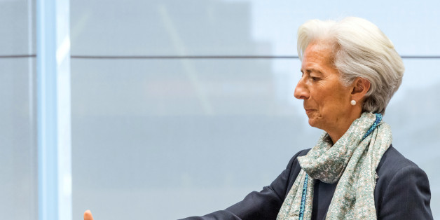 Managing Director of the International Monetary Fund Christine Lagarde reaches out to shake hands as she arrives for a meeting of eurogroup finance ministers at the European Council LEX building in Brussels on Monday, June 22, 2015. Heads of state in the eurogroup meet in Brussels on Monday for a special summit to discuss the financial crisis with Greece. (AP Photo/Geert Vanden Wijngaert)