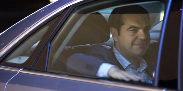 Greek Prime Minister Alexis Tsipras leaves in his car after a meeting at EU headquarters in Brussels on Wednesday, June 24, 2015. Eurozone finance ministers meet Wednesday to discuss the Greek bailout. (AP Photo/Virginia Mayo)