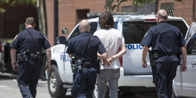 BOSTON, MA - JUNE 24:  A man is taken into custody after a meat cleaver was found in his car in front of John Joseph Moakley United States Courthouse during the formal sentencing of Boston Marathon Bomber Dzhokar Tsarnaev on June 24, 2015 in Boston, Massachusetts. Dzhokar Tsarnaev was found guilty on all 30 counts related to his involvement in the 2013 bombing, which resulted in three deaths and over 250 injuries.  (Photo by Scott Eisen/Getty Images)