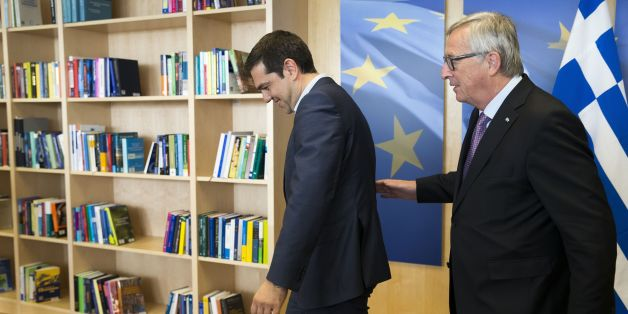 Greece's Prime Minister Alexis Tsipras (L) is welcomed by European Commission President Jean-Claude Juncker (R) ahead of a meeting on Greece, at the European Commission in Brussels,on June 24, 2015, as eurozone finance ministers try to finalise a debt deal and avoid a default by Athens. Greek Prime Minister Alexis Tsipras is set to conduct yet another round of crisis talks with representatives of the country's creditors, ahead of a crucial meeting of eurozone finance ministers where all sides ho