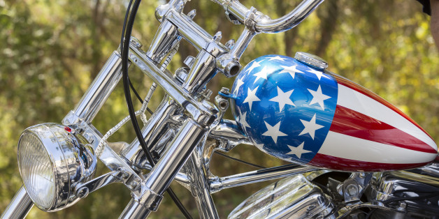"""This Thursday, Sept. 4, 2014 photo shows a detail of the Captain America chopper Peter Fonda rode in """"Easy Rider"""" at the Profiles in History auction house in Calabasas, Calif. It's one of the most recognizable motorcycles of all time. The auction house Profiles in History tells The Associated Press it estimates the Harley-Davidson will bring between $1 million and $1.2 million at its Oct. 18, 2014 sale. (AP Photo/Damian Dovarganes)"""