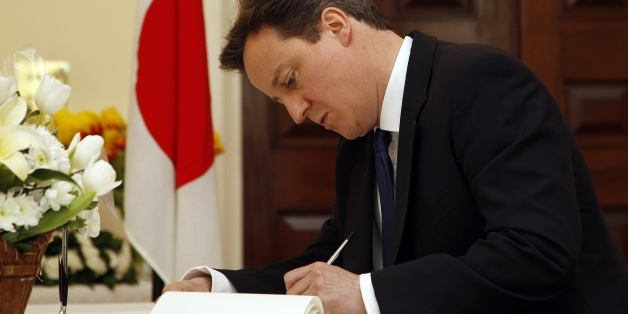 Britain's Prime Minister David Cameron signs a book of condolence for the victims of the recent earthquake and tsunami  at the Japanese embassy in London Tuesday March 22, 2011. (AP Photo/Stefan Wermuth, Pool)