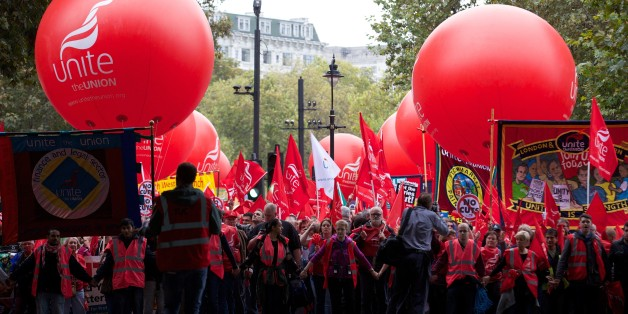Thousands of people march in London on October 18, 2014, against falling real wages. The event is organised by The Trades Union Congress (TUC), a federation of the country's main trade unions. AFP PHOTO/ANDREW COWIE        (Photo credit should read ANDREW COWIE/AFP/Getty Images)
