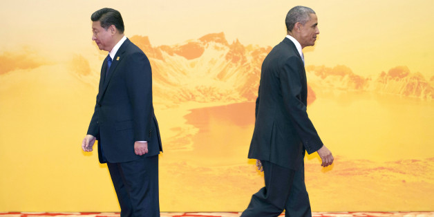 U.S. President Barack Obama walks past Chinese President Xi Jinping during a welcome ceremony for the Asia-Pacific Economic Cooperation (APEC) Economic Leaders Meeting held at the International Convention Center in Yanqi Lake, Beijing, on Tuesday, Nov 11, 2014. (AP Photo/Ng Han Guan)