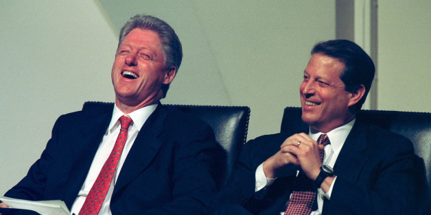 President Bill Clinton laughs along with Vice President Al Gore after comments about Gore being part of the 'granola and sandals crowd' because of his commitment to science during a discussion on the computer glitch known as the Year 2000 problem or by it's acronym 'Y2K' at the National Academy of Science July 14, 1998 in Washington, DC. The glitch involves the failure of computer software to recognize the year 2000 and can potentially cause massive problems in government and industry. (photo by Richard Ellis)