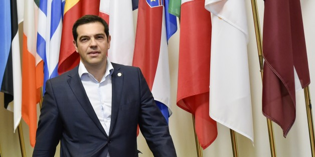 Greek Prime Minister Alexis Tsipras arrives to speak to journalists after an EU summit at the EU headquarters in Brussels on June 26, 2015. German Chancellor Angela Merkel urged Greece on Friday to accept an 'extraordinarily generous' offer from its EU-IMF creditors, which includes at least 12 billion euros ($13.4 billion) in further rescue cash over the next five months. Merkel and French President Francois Hollande asked Greek premier Alexis Tsipras to 'accept the extraordinarily generous offe