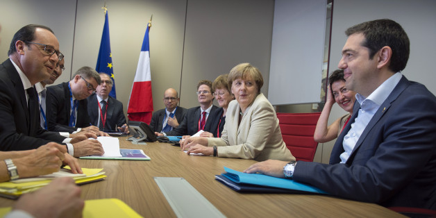BRUSSEL, BELGIUM - JUNE 26:  In this photo provided by the German Government Press Office (BPA), German Chancellor Angela Merkel, French President Francois Hollande (L) and Greek Prime Minister Alexis Tsipras (R) attend a meeting at the beginning of the second day of the European Summit on June 26, 2015 in Brussel, Belgium. (Photo by Guido Bergmann/Bundesregierung via Getty Images)