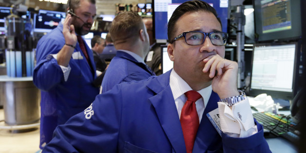 Specialist Paul Corsentino, right, works at his post on the floor of the New York Stock Exchange Wednesday, June 17, 2015. Investors are waiting for a policy statement from the Fed that could indicate if it is moving closer to raising its benchmark interest rate. (AP Photo/Richard Drew)