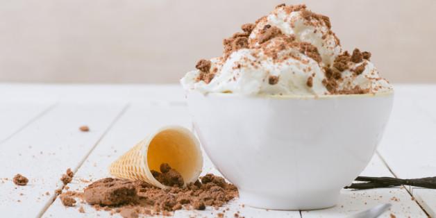 Vanilla Ice Cream on the white wooden table.