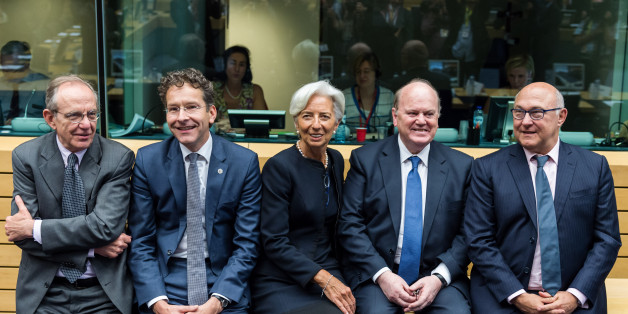 Managing Director of the International Monetary Fund Christine Lagarde, center, talks with Dutch Finance Minister and chair of the eurogroup Jeroen Dijsselbloem, second left, Italy's Finance Minister Pier Carlo Padoan, left, Ireland's Finance Minister Michael Noonan, second right, and France's Finance Minister Michel Sapin during a meeting of eurozone finance ministers in Brussels on Thursday, June 25, 2015. Greece and its creditors launched a new round of talks in Brussels early Thursday in a fresh bid to unlock billions of euros in loans and save the country from bankruptcy. (AP Photo/Geert Vanden Wijngaert)